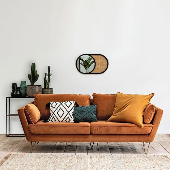 Canapé en velours sur pieds épingles